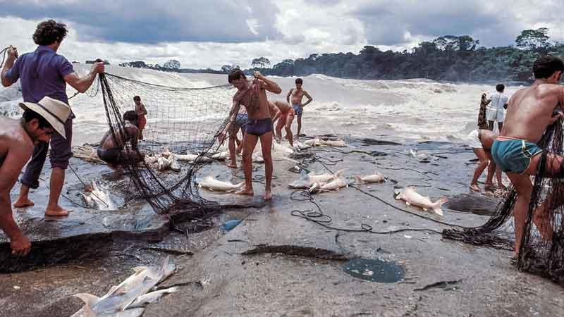 Men fishing the Amazon river