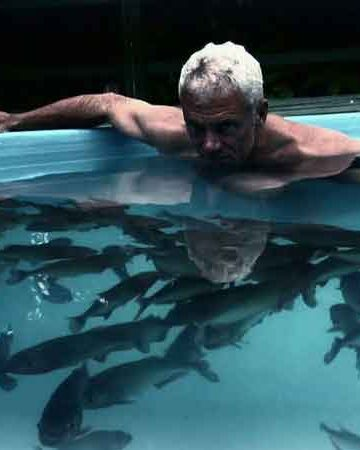 Man in Piranha Pool