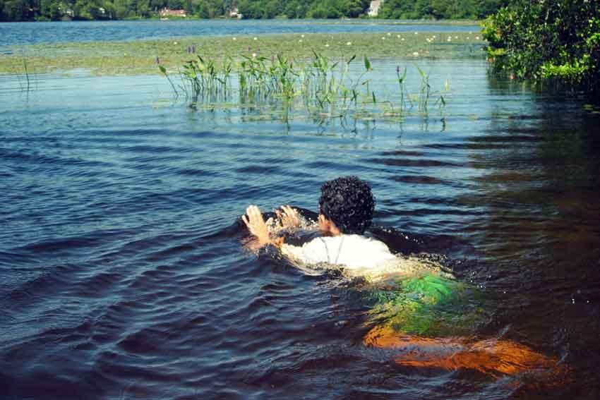 a man swimming across a river