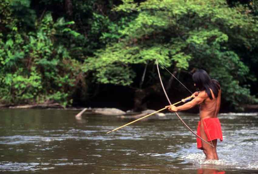 a fisherman bow hunting in the amazon river